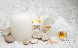 Candle, orcids and stones Royalty Free Stock Images