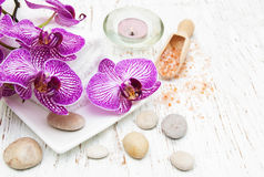 Candle, orcids and towels Stock Photo