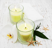 Candle, orcids and towels Stock Photos