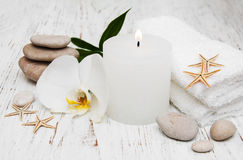 Candle, orcids and towels Royalty Free Stock Images