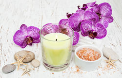 Candle, orcids and towels Royalty Free Stock Photos