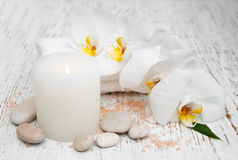 Candle, orcids and towels Royalty Free Stock Photo
