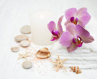 Candle, orcids and towels Stock Images