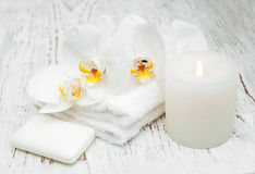 Candle, orcids and towels Royalty Free Stock Photography