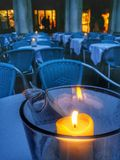 Candle on an outdoors restaurant table Royalty Free Stock Image
