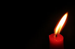 Candle over black Stock Images