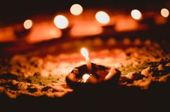 Candle over rangoli royalty free stock image