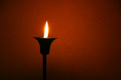 Candle over red wall Stock Images