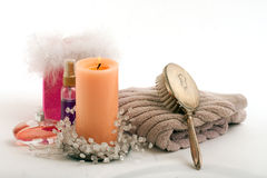 Candle perfume lotion towel hair brush in spa Stock Photos