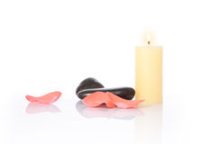 Candle, petal and Pebbles Stock Image