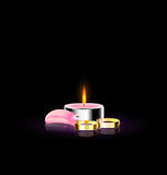 Candle with petal and ring. Black background and burning candle with pink petal and two rings Royalty Free Stock Image