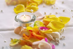 Candle and petals decoration Royalty Free Stock Image