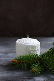 Candle with pine branches on the boards Stock Image