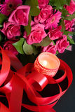 Candle and pink flowers bouquet Royalty Free Stock Images