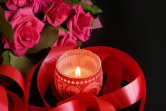 Candle and pink roses Royalty Free Stock Photo