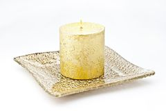 Candle on the plate. Royalty Free Stock Images