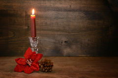 Candle with poinsettia flower Stock Photo