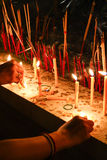 Candle Pray. In buddhism worship, people will light candle before light a joss stick. Lighting candle mean to respect the Buddha's teaching Royalty Free Stock Image