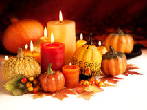 Candle and pumpkins Royalty Free Stock Image