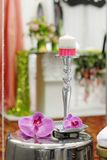 Candle and purple orchid as decorations Royalty Free Stock Photos