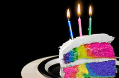 Candle in rainbow cake Royalty Free Stock Photography