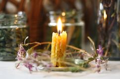 Candle of real wax, made with your own hands and medicinal herbs royalty free stock photography