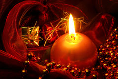 Candle on red Stock Images