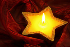 Candle on red Royalty Free Stock Photography