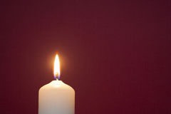 Candle before red Stock Photo