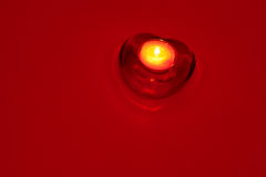 Candle on red background Stock Photos