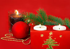 Candle and red decoration Stock Photography