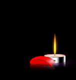 Candle and red petal. Black background and burning candle with red petal Royalty Free Stock Photography