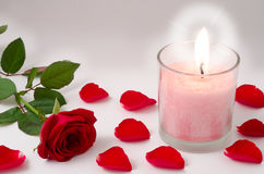 Candle and red rose Stock Images