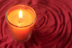 Candle on Red sand Stock Image