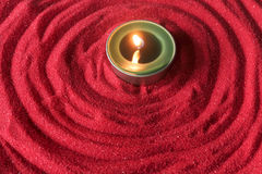 Candle on red sand with circle shape Stock Images