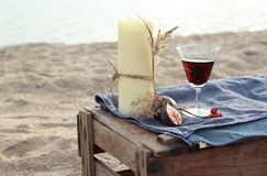 Candle and red wine on the beach Royalty Free Stock Photos