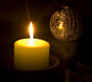 Candle reflecting in a Christmas ball Royalty Free Stock Image