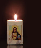 Candle with religion motiff Royalty Free Stock Images