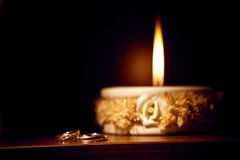 Candle and rings Stock Photography