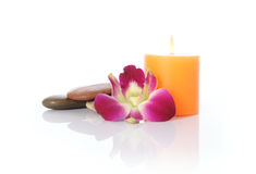 Candle, River Stones and Orchid Royalty Free Stock Images