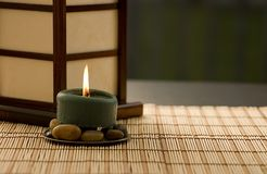 Candle on Rocks Royalty Free Stock Images