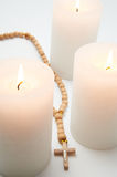 Candle and rosary Stock Image
