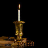 Candle with rosary Stock Image