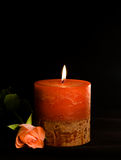 Candle and rose. Isolated on black stock photography