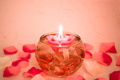 Candle Rose. Candle in form of rose in a bowl with water and petals around Stock Image