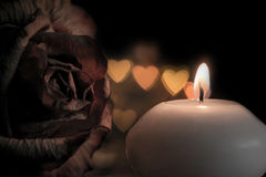 Candle with rose flower on bokeh hearts background. Vintage style. Royalty Free Stock Images