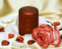 Candle and rose with hearts. Celebration candle and rose with hearts Royalty Free Stock Photo