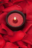 Candle and rose petals Stock Photo