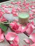Candle and rose Stock Photos