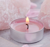 Candle and rose quartz decoration for spa Royalty Free Stock Photo